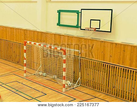 Basket ball hoop in empty basketball court,  school sporting hall