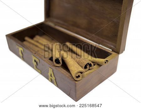 Cinnamon in wooden box isolated on white background