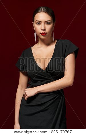 Portrait of sensual beautiful woman in black evening gown