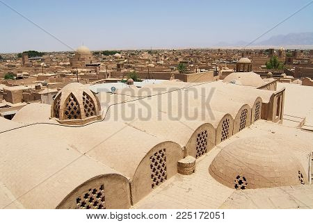 YAZD, IRAN - JUNE 17, 2007: View to the roofs of the old buildings in the historical part of the Yazd city, Iran.