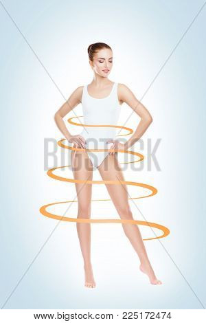 Slim and sporty female body. Fit and healthy girl in swimsuit. Health, sport, fitness and weight loss concept.