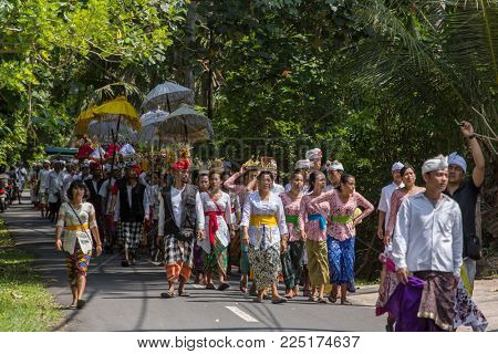 Bali, Indonesia - September 16, 2016: Traditional balinese procession during Galungan celebration in Ubud, Indonesia