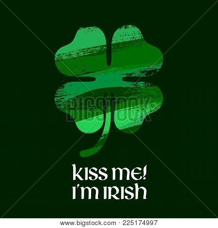 Kiss me I'm Irish message illustration. St Patrick's day design with green paintbrush smudges clover shamrock.