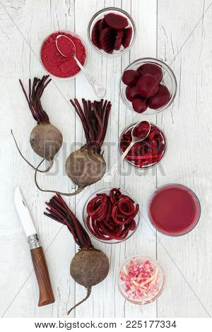 Beetroot health and super food with smoothie juice drink, fresh, powder, sliced, pickled and shredded beetroots.  Has medicinal properties and contains anthocyanins, vitamins and antioxidants.