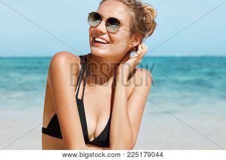 People, Recreation And Summer Holidays Concept. View Of Adorable Young Female In Stylish Swimwear An