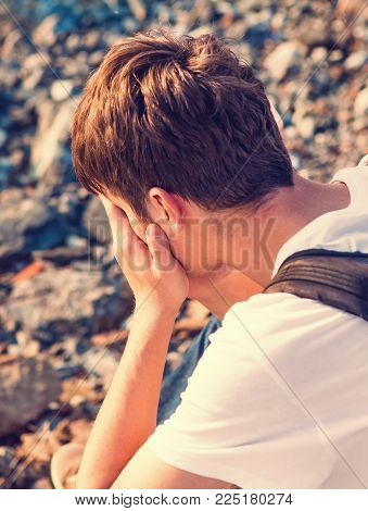 Toned Photo of Sad Young Man outdoor
