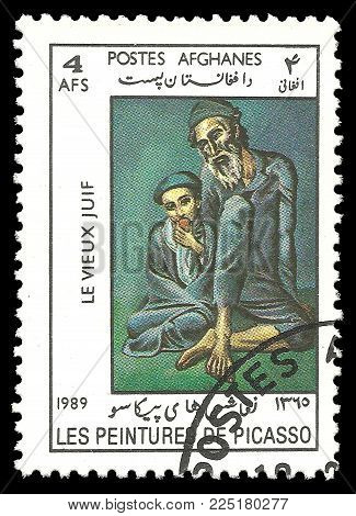 Afghanistan - circa 1989: Stamp printed by Afghanistan, Color edition on Art, shows Painting Old blind man with boy by Pablo Picasso, circa 1989
