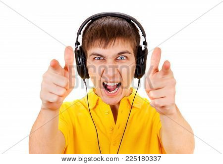 Young Man in Headphones Pointing Isolated on the White Background