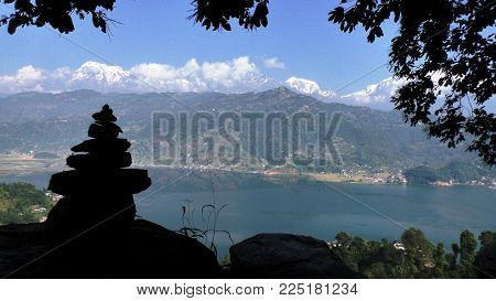Cairns on path at Pokhara lake in front of Himalaya, Nepal