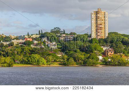 Guaiba lake beach with buildings and trees, Porto Alegre, Rio Grande do Sul, Brazil