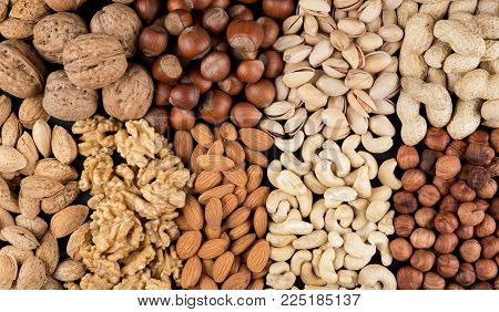 Walnuts, Peanuts, Pistachios, Almonds, Cashews And Hazelnuts Isolated On Black. Raw Food Ingredients