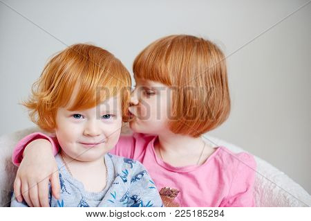 Red-haired brother and sister share a secret