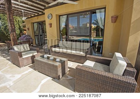 Patio Area With Sofa And Table At A Luxury Tropical Holiday Villa Resort