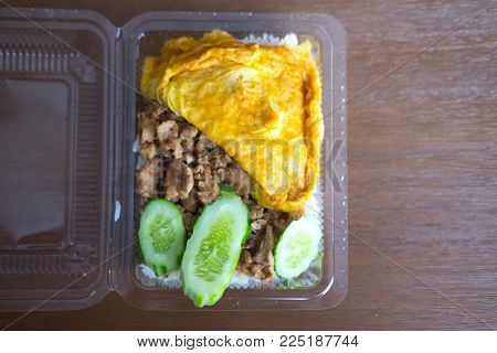 Thailand Food, Pork Mix Garlic And Pepper With Omelet.