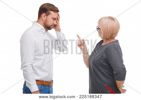 Generation conflict. Young man and older woman disagreement