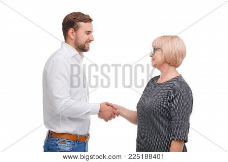 Generation agreement. Young man and older lady handshake