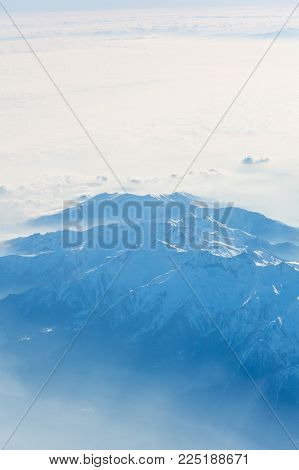 Aerial View Of The Swiss Alps. Flying Over Alps. Mazing View On Mountain.