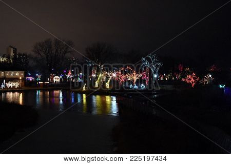 Multiple Christmas Holiday Lights On Trees Reflecting In Water At Zoo Lights, Lincoln Park Zoo, Chic