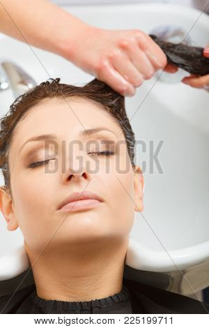 Hairdresser Washing Her Woman Customer Hair