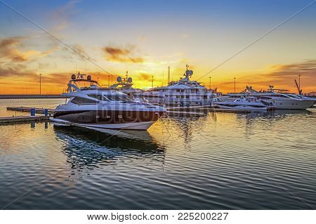 SOCHI, RUSSIA - April 26, 2015: Wharf at sunset