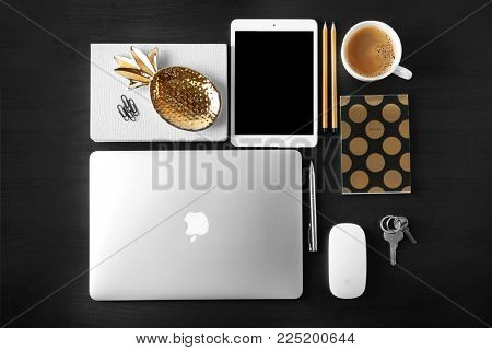 KYIV, UKRAINE - OCTOBER 23, 2017: Flat lay composition with Apple MacBook Air Silver and iPad mini 4 on dark background