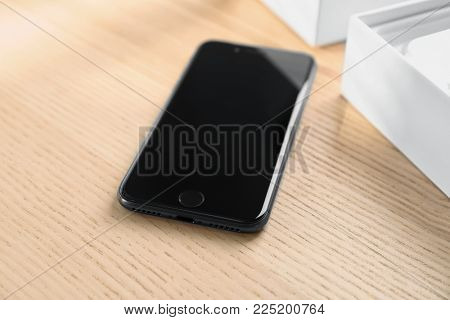 KYIV, UKRAINE - DECEMBER 5, 2017: iPhone 8 Space Grey with blank screen on table