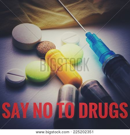 Man From The Pills Lies Next To The Syringe. Say No To Drugs Concept