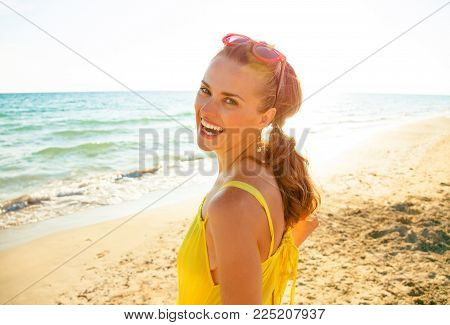 Colorful And Wonderfully Cheerful Mood. Full Length Portrait Of Happy Young Woman In Colorful Dress