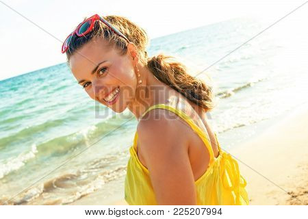 Happy Modern Woman In Colorful Dress On Beach In Evening