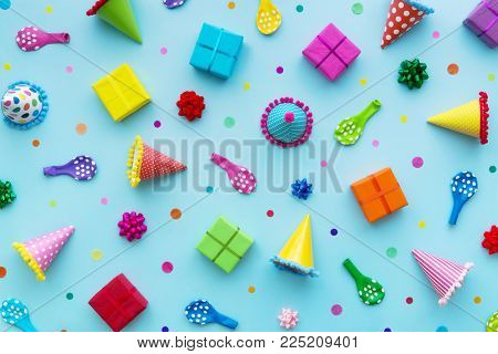Birthday party background with party hats and birthday gifts
