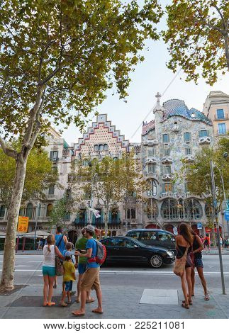 Barcelona, Spain - August 25, 2014: Tourists walk on Passeig de Gracia one of the major avenues in Barcelona, Catalonia