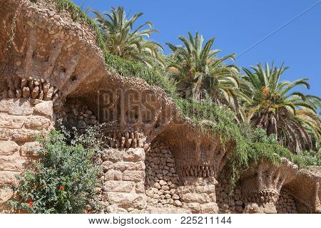 Barcelona, Spain - August 26, 2014: Park Guell, stone terrace walls designed by Antonio Gaudi