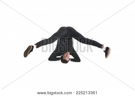 Guy performs a backflip upside down isolated on white background for any purpose