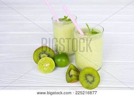 Kiwi Smoothie Yogurt, Juice Fruit And Kiwi, Fruit For Breakfast In The Morning On A Wooden Floor.