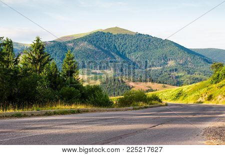 road in to the mountains through forest. serpentine near the Volovets town, TransCarpathia, Ukraine