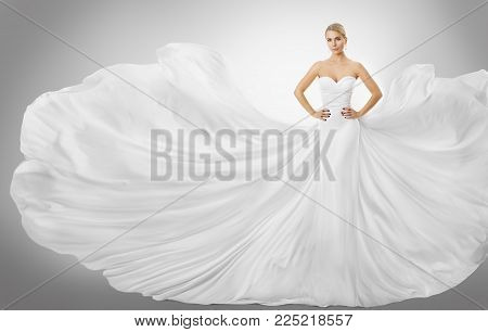 Woman White Flying Dress, Elegant Fashion Model Posing in Wedding Fluttering Gown, Bride Art Beauty Portrait