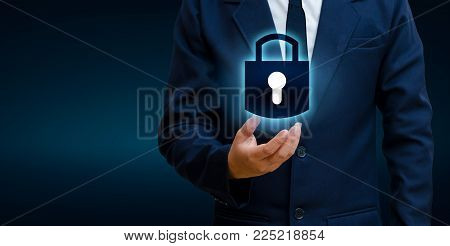 lock In the hands of a businessman Shield the shield to protect the cyberspace.Space input data Data Security Business Internet Concept. Secure information