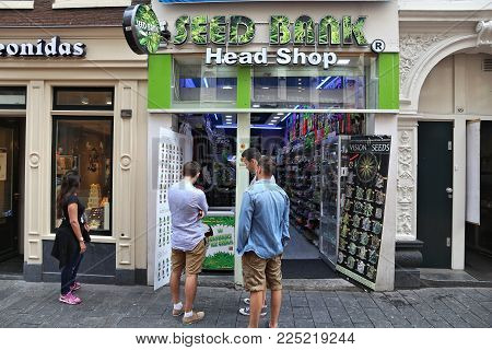 Amsterdam, Netherlands - July 7, 2017: People Visit A Cannabis Seed Shop In Amsterdam, Netherlands.
