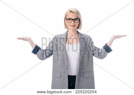 attractive elegant businesswoman with shrug gesture, isolated on white