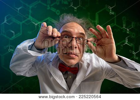 funny chemistry professor adjusts his glasses and look in camera