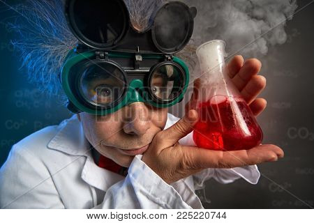 Funny professor with protective glasses and test tube