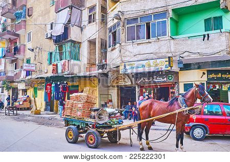 Alexandria, Egypt - December 17, 2017: The Vegetable Cart Drawn By Horse In The Street Of Residentia