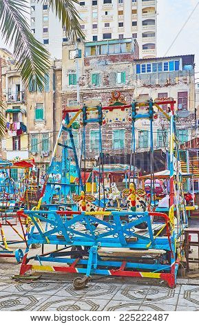 The Luna Park With Different Vintage Swings In Bright Colors Is Located In Residential Neighborhood