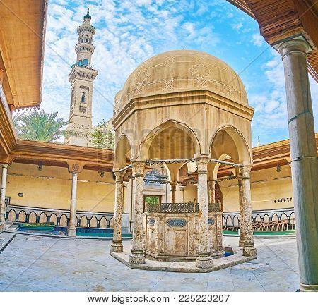 The Yard Of Imam Busiri Mosque With Old Stone Ablution Fountain And Minaret Of Abu Al-abbas Al-mursi