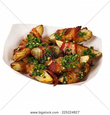 Bacon Wrapped Potatoes Wedges with Parsley Garlic Pesto Sauce Isolated on White background. Selective focus.