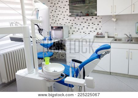 Dental ordination with blue dental chair and apparatus