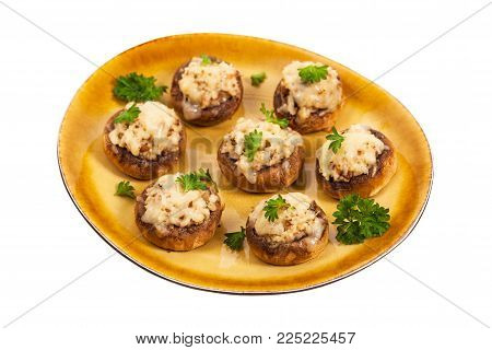 Vegetarian Stuffed Mushrooms Isolated on White Background. Selective focus.