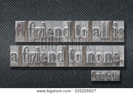 A friend to all is a friend to none - ancient Greek philosopher Aristotle quote made from metallic letterpress on dark background