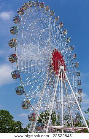 Ferris wheel against the sky. Ferris wheel.