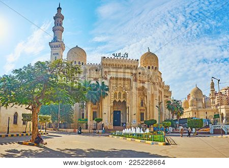 ALEXANDRIA, EGYPT - DECEMBER 17, 2017: The carved stone facade of Abu al-Abbas al-Mursi Mosque with tall minaret and domes, decorated with complex patterns, on December 17 in Alexandria.